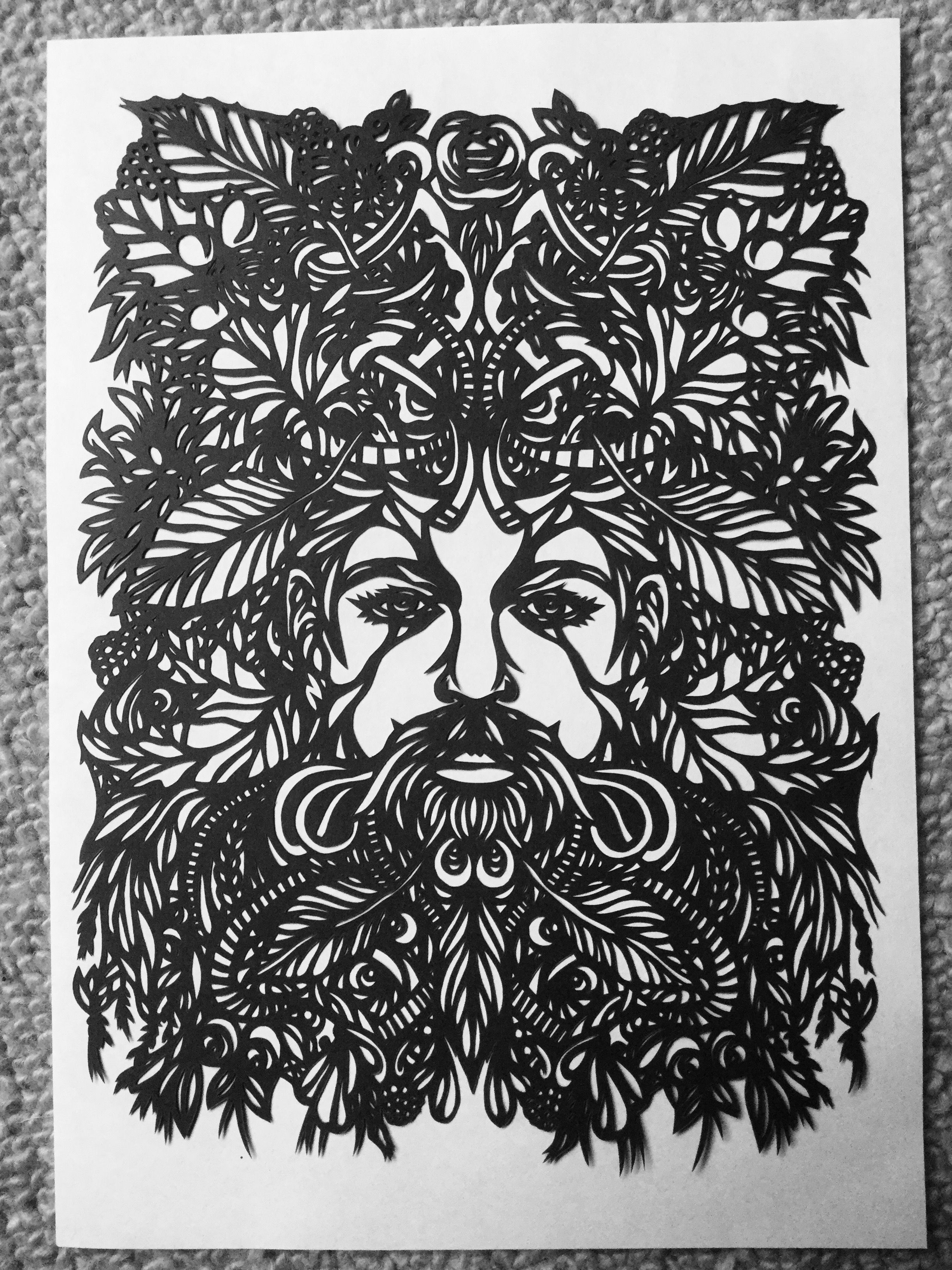 Paper Cut Image Of The Green Man Cut From 130Gsm