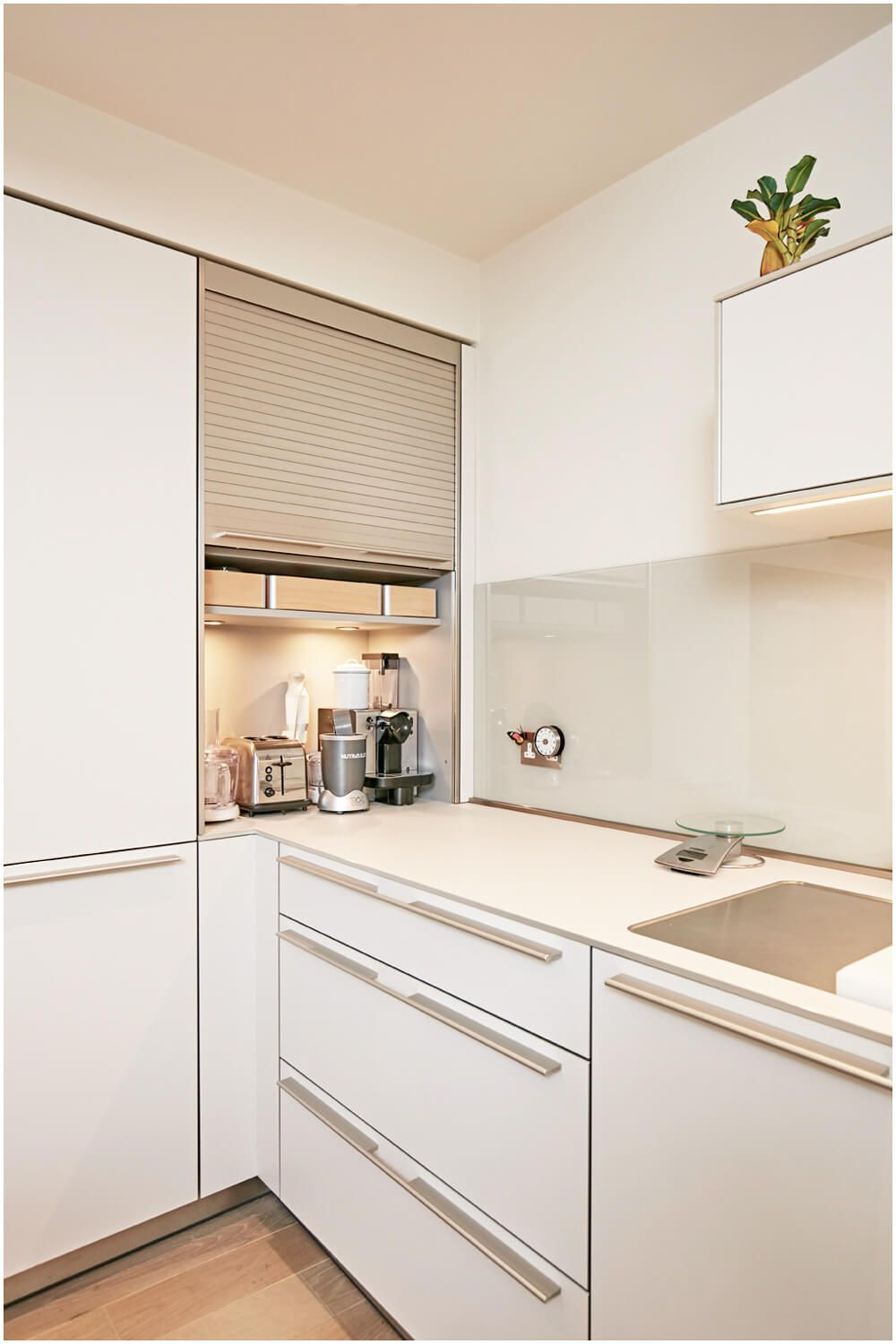 A Bulthaup B3 Roller Shutter Cabinet Creates A Space To Hide Away Those Everyday Items That Often Clutter Kitchen Layout Modern Kitchen White Kitchen Design
