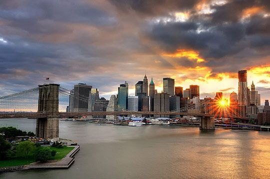 Sunset over the Brooklyn Bridge and Lower Manhattan, New York City by Andrew Mace