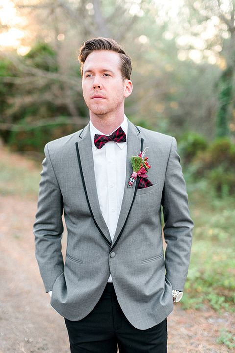 Christmas inspired wedding shoot at south coast botanic gardens groom grey tuxedo coat with black pants and white dress shirt with red plaid bow tie and red floral boutonniere