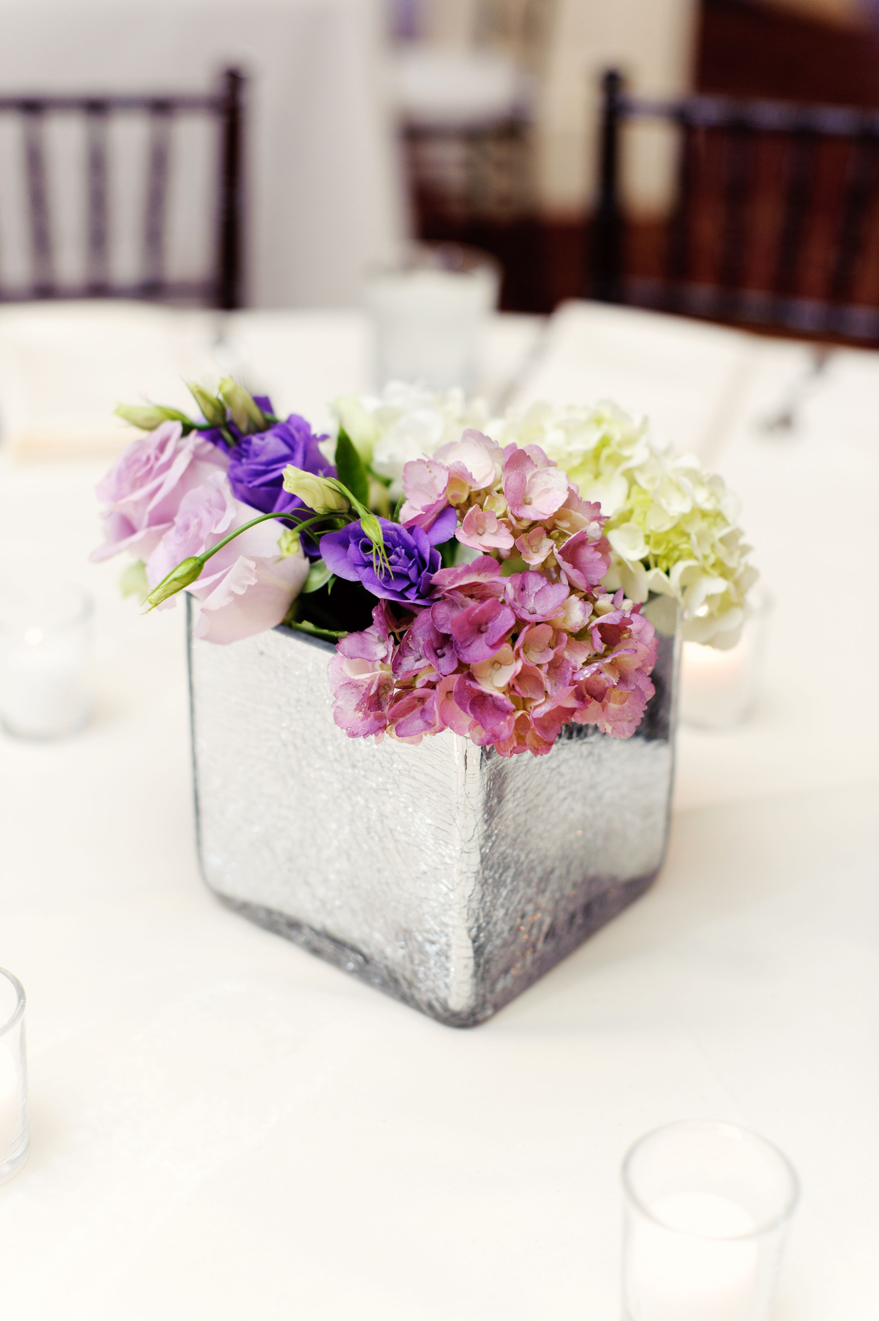Simple centerpieces with mirrored vases. Celina Gomez Photography ...
