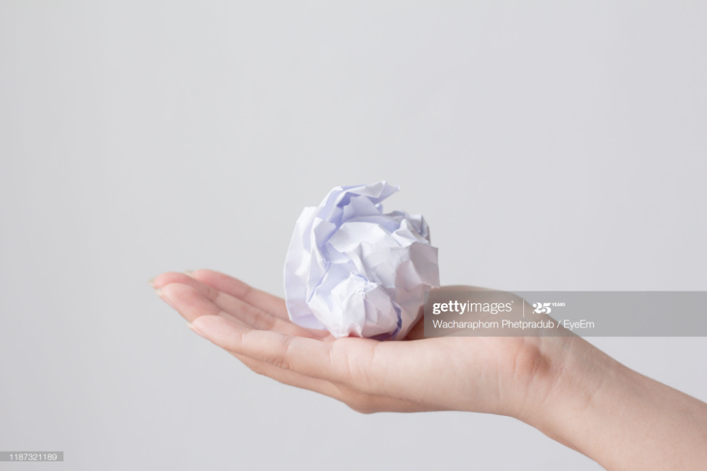 Cropped Hand Of Person Holding Crumpled Paper Ball Over White Crumpled Paper Paper Balls Person