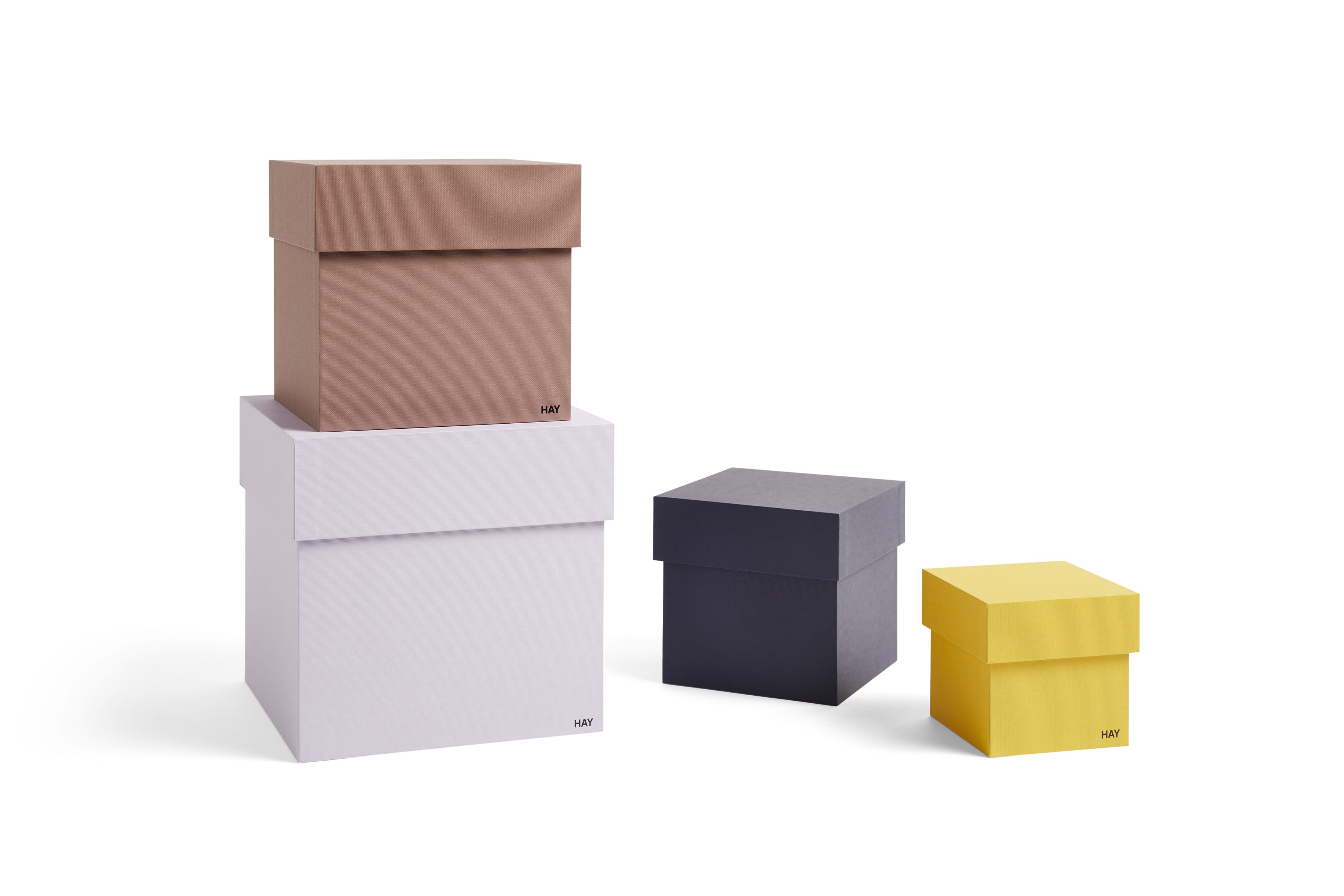 Box Box combines sizes and colours to organise and store smaller items. Made in thick cardboard with matching lid.