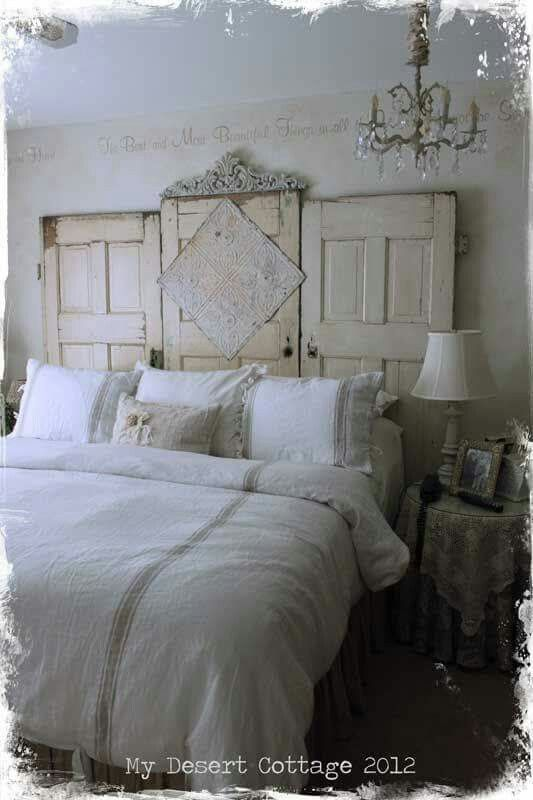 love how these old doors were made into a headboard just be sure