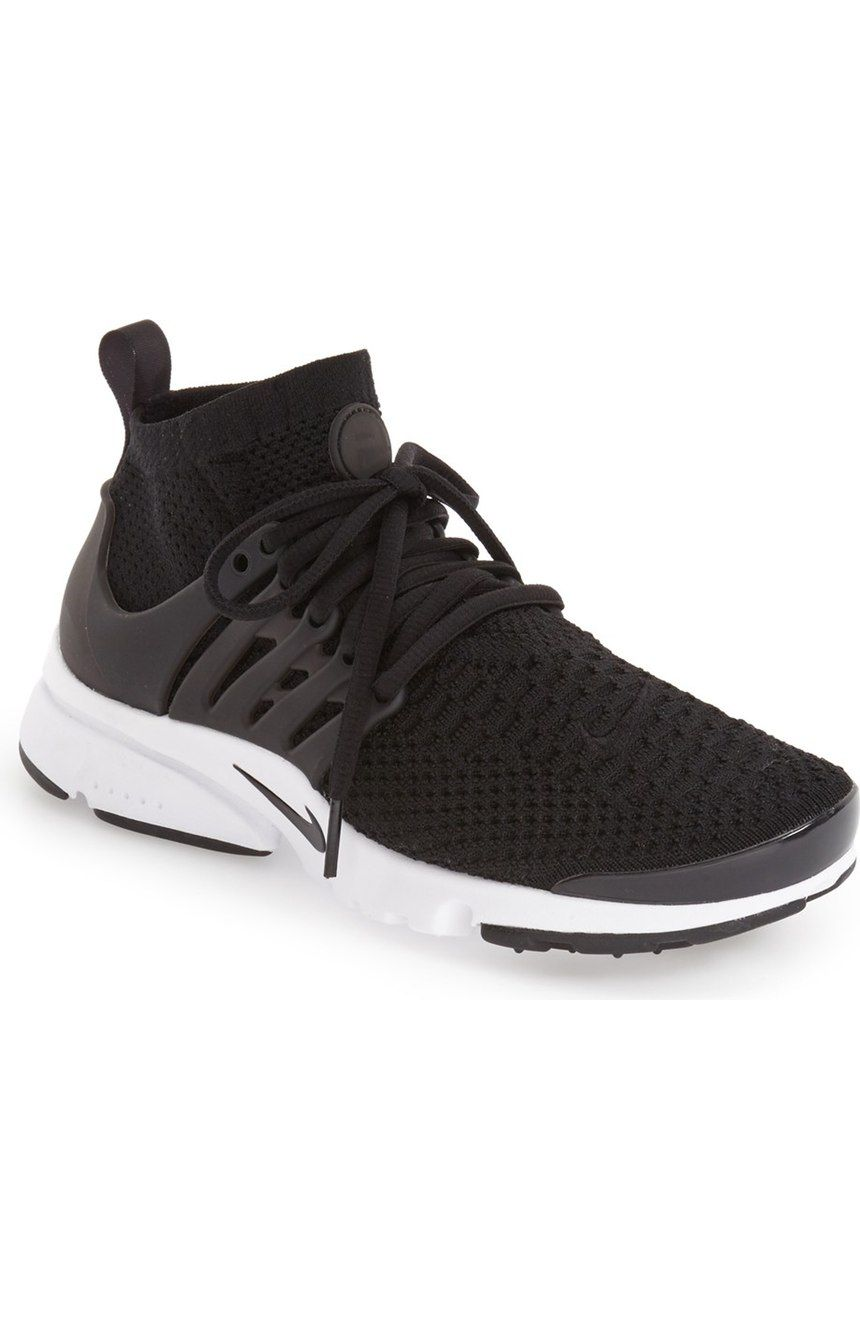 the latest 5e893 e4ef4 Crisp, clean and ready for the streets, this retro-futuristic runner from  Nike boasts a breathable stretch-mesh upper, contrast accents and a  signature ...