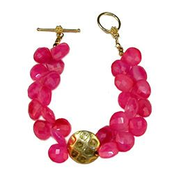 It's all in the wrist: The deep pink beads (made of chalcedony—a quartz-y-ish mineral) and abstract gold charm give this 7.5-inch bracelet plenty of pizzazz.