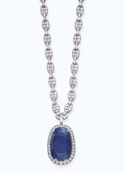 AN ART DECO SAPPHIRE AND DIAMOND SAUTOIR   Designed as a series of oval-shaped openwork links of geometric design, set with circular and single-cut diamonds, spaced by baguette-cut diamonds, suspending a cushion-shaped sapphire pendant, weighing approximately 128.50 carats, within an old European-cut diamond surround, mounted in platinum, circa 1925, 21 ins., with French assay marks and indistinct maker's mark