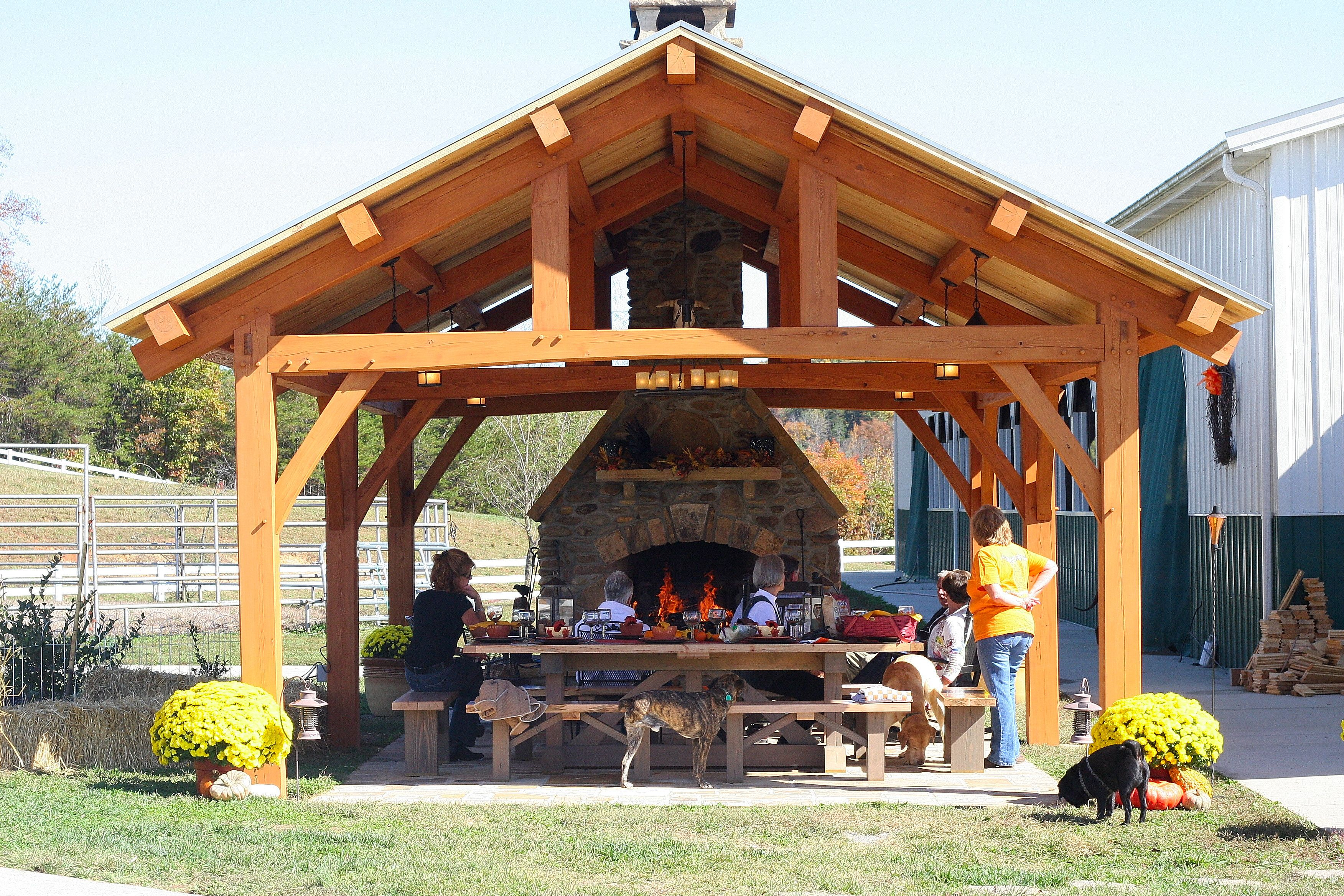 Outdoor living timber frame pavilion timber frame for Plans for gazebo with fireplace