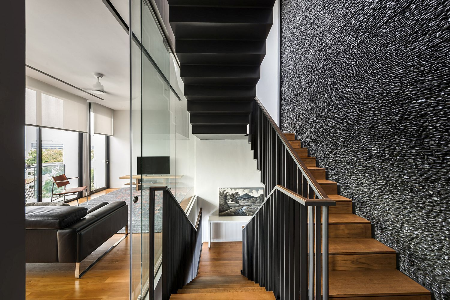 Polished Feature Wall with Black River Pebbles Captivates at Toh