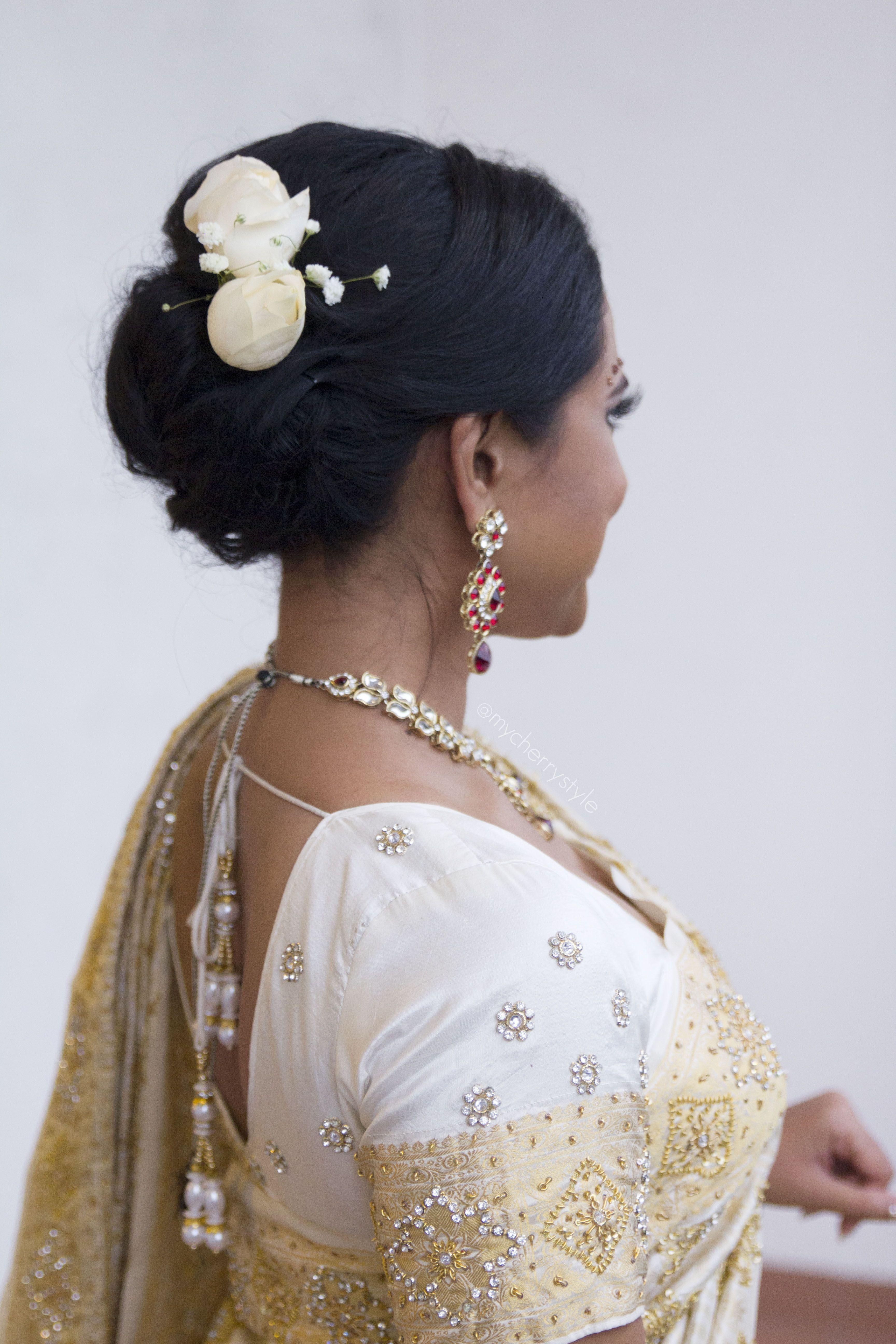 Modern Indian bridal hairdo/updo with white roses   Brides ...