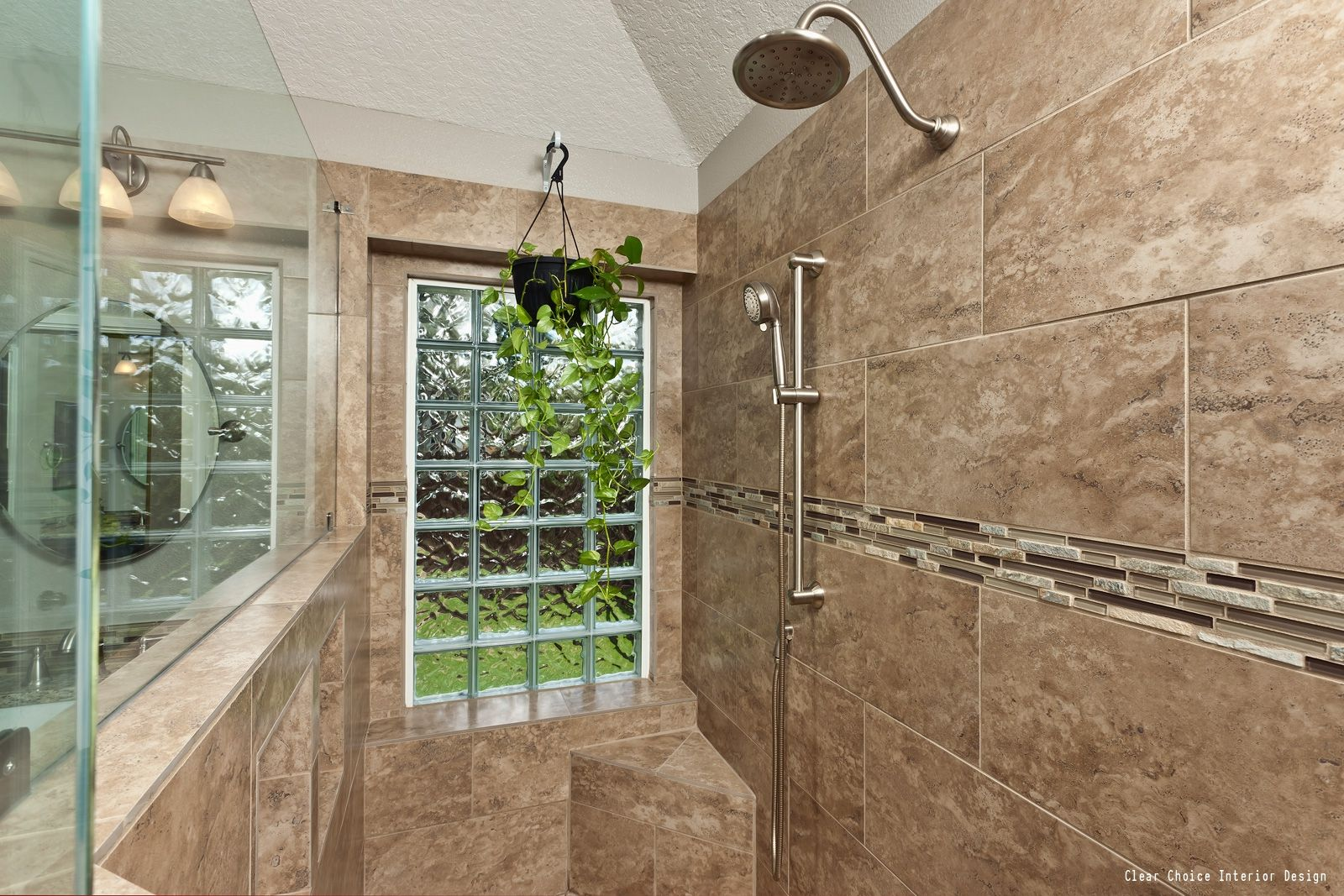 A Beautiful Shower With Brown Tile And A Large Window Looking To