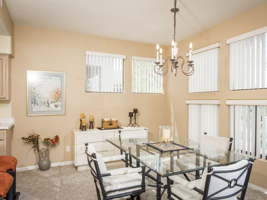 Enjoy peaceful meals in this private townhome nestled in the guard-gated community of Gainey Ranch.