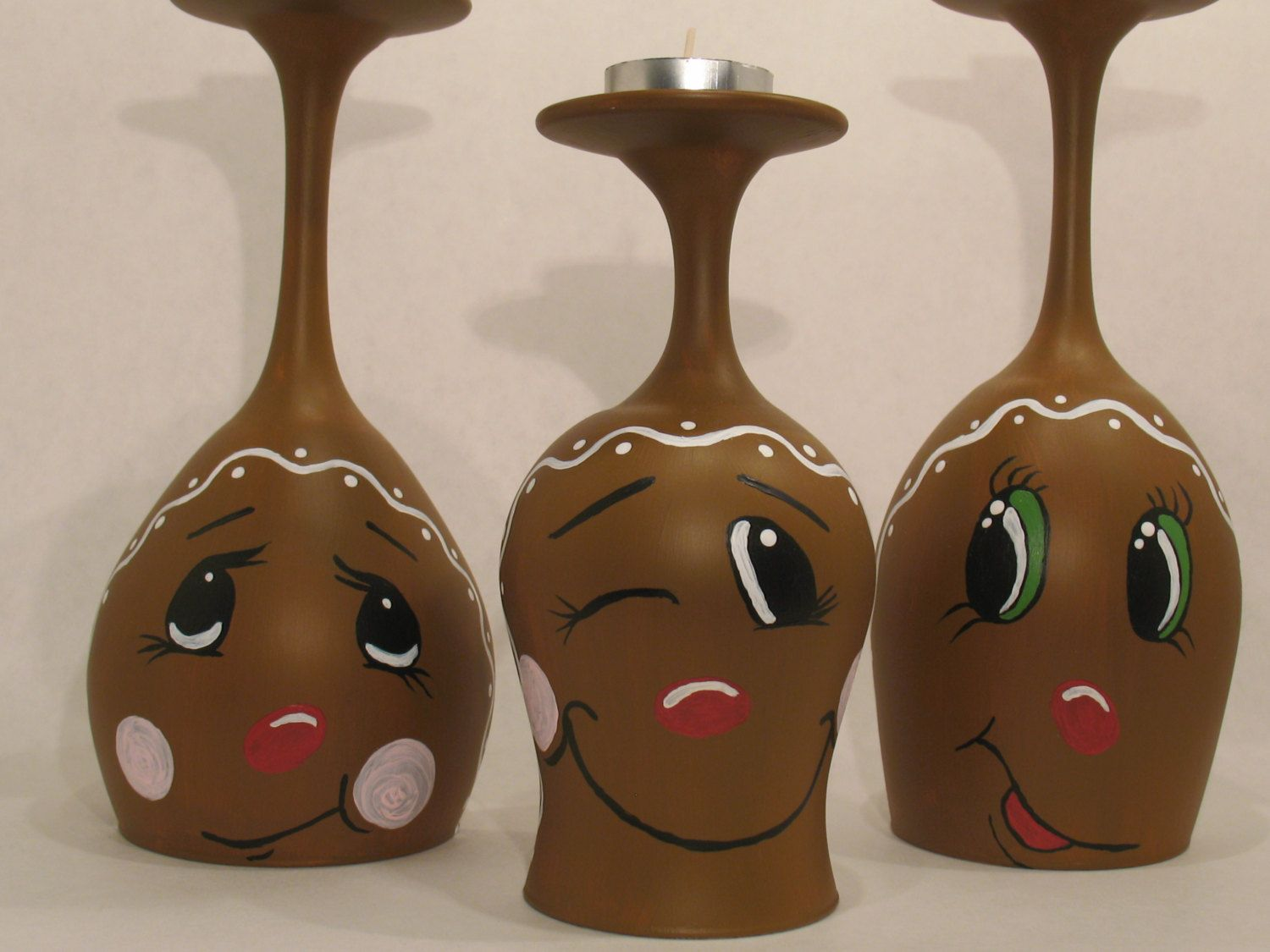 Gingerbread men wine glass candle holders by for Wine bottle candle holder craft
