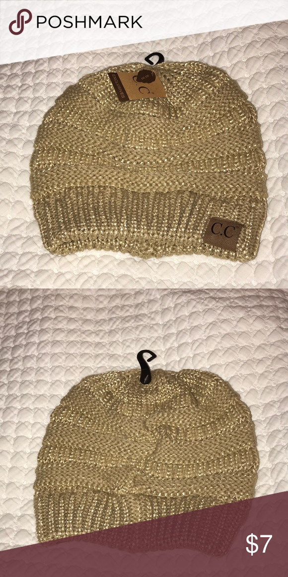 43c359f0a48 C.C tan beanie with gold accents