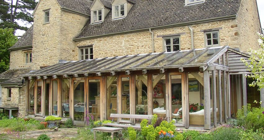 Garden room and oak framed conservatory extension for Wooden garden rooms extensions