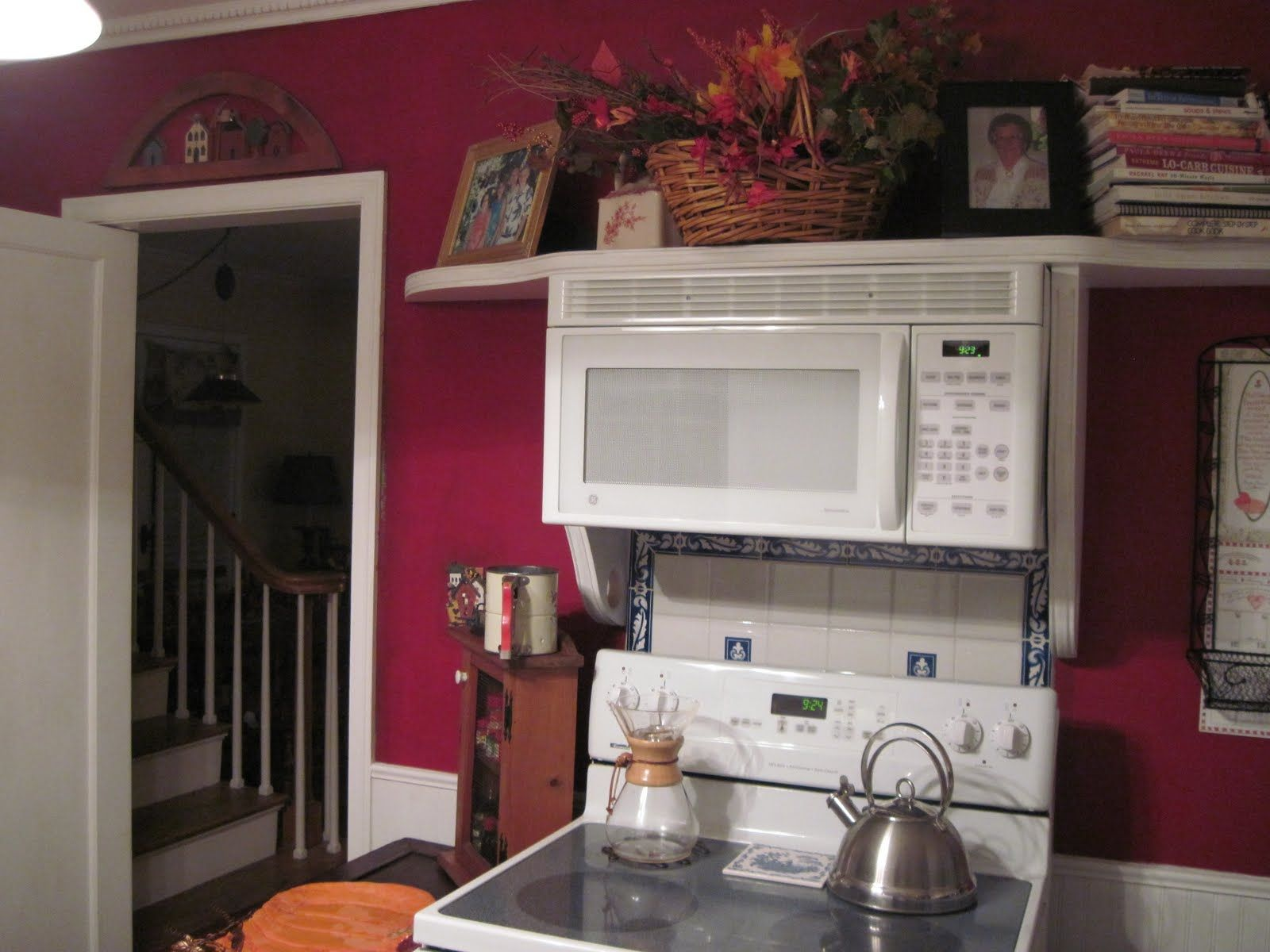 open shelf instead of cupboard above stove; microwave mounted to ...