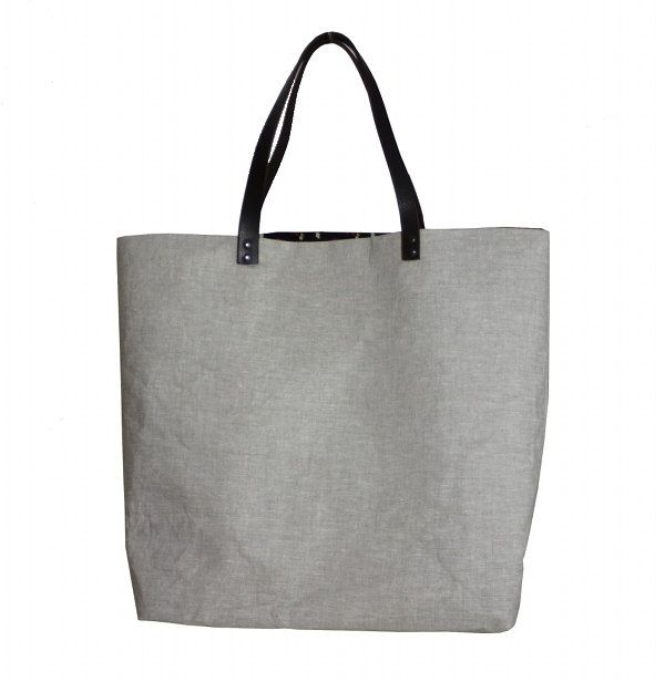 linen bag with leather handles.