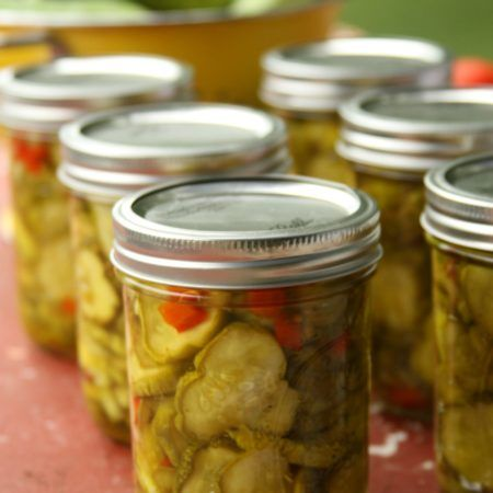 Homemade Bread and Butter pickles in Mason jars on barn ...