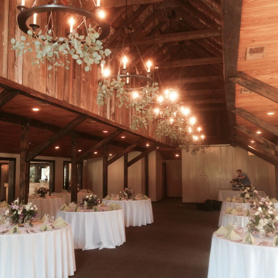 Greenery on chandeliers, magnolia carriage house, by