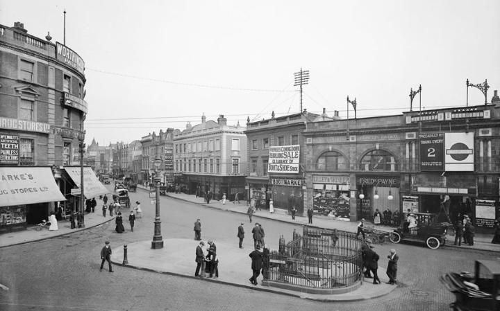 Hammersmith Broadway with the underground station on the right and elaborate railings at the entrance to public conveniences in the centre (1910).