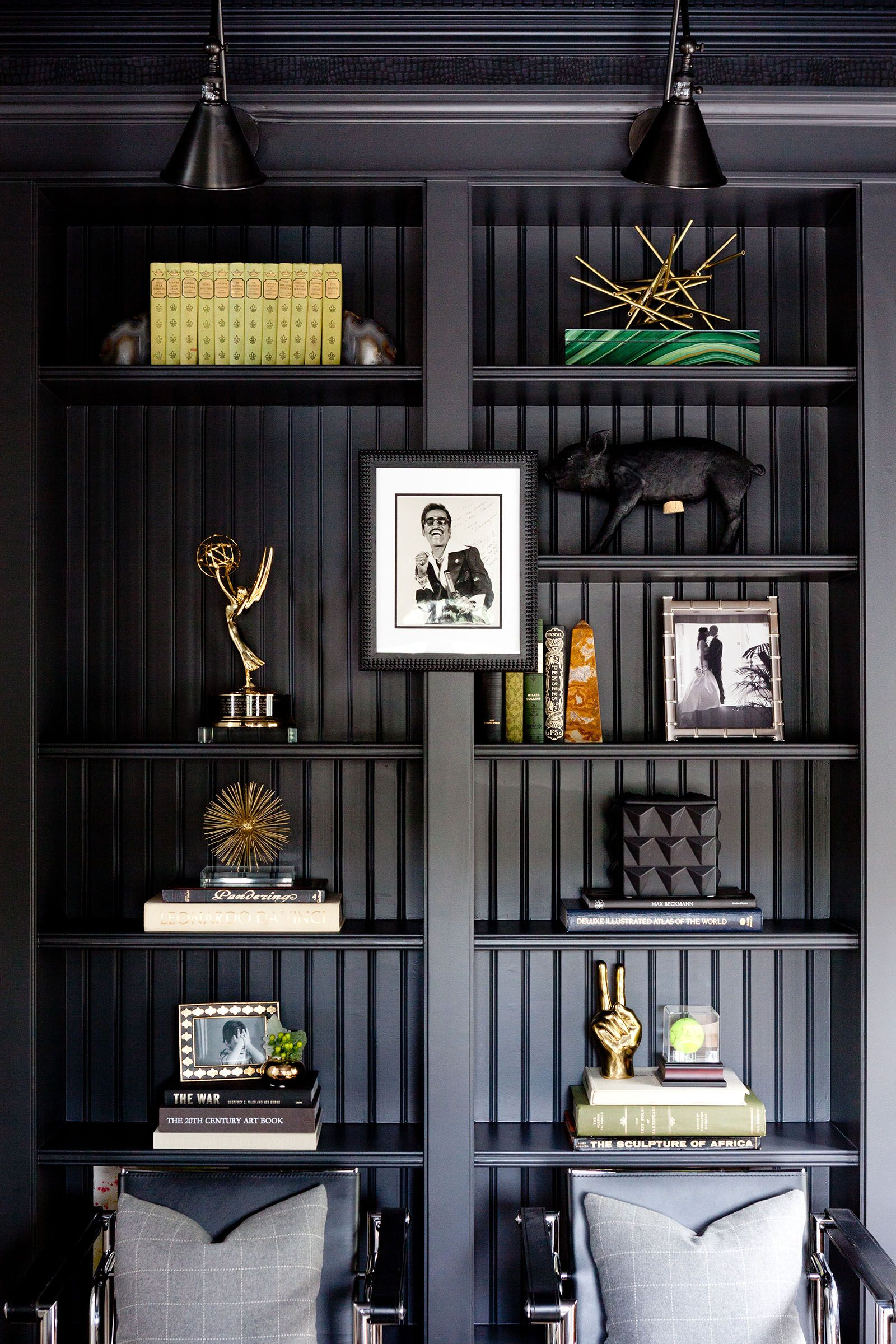 Black Built Ins With Black Paneling Backing And Black Wall Sconces