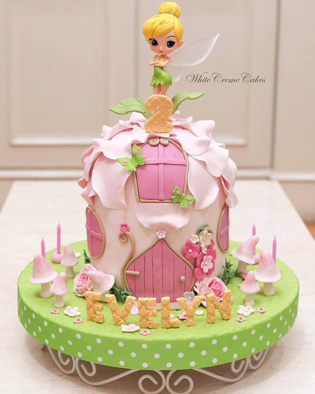 This Beautiful Tinkerbell Cake Is Sure To Be Any Girl S Birthday Wish Come True Whitecremecakes Tinkerbell Cake Fairy House Cake 1st Birthday Cakes