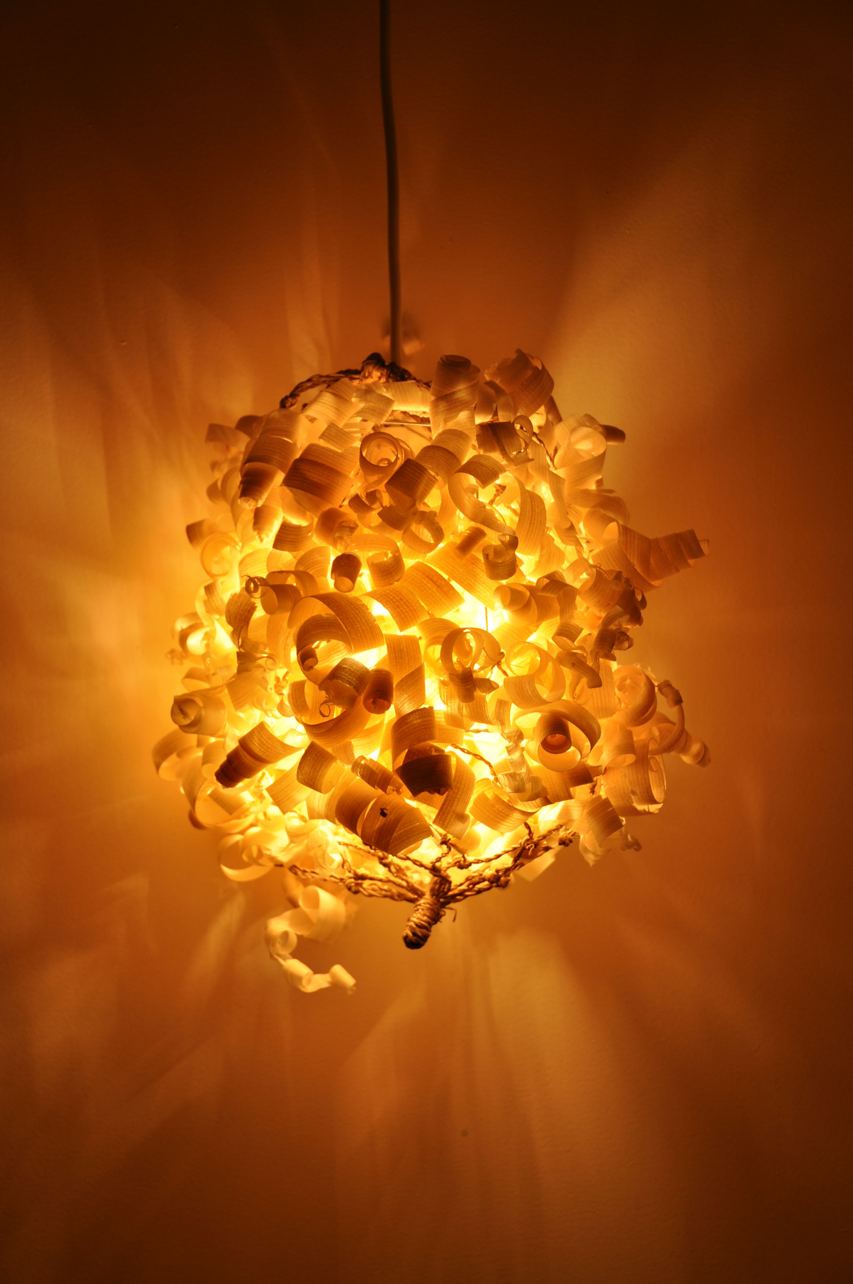 Delightful Homemade Lamp, Wood Shavings On Grid.