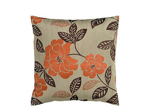 This floralpatterned taupe and burnt orange throw pillow will give