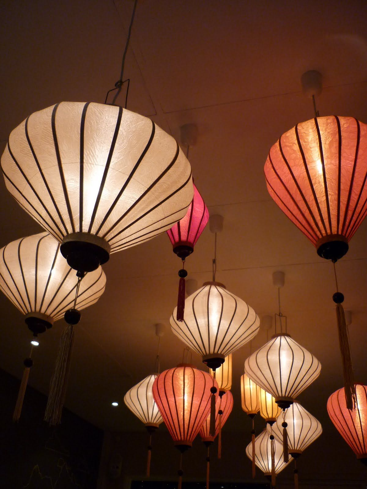 Sophisticated Hoi silk lanterns suspended from ceiling