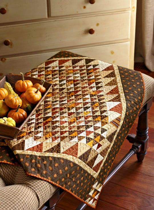 How I love autumn colors in a quilt. Also love the simplicity of just triangles.