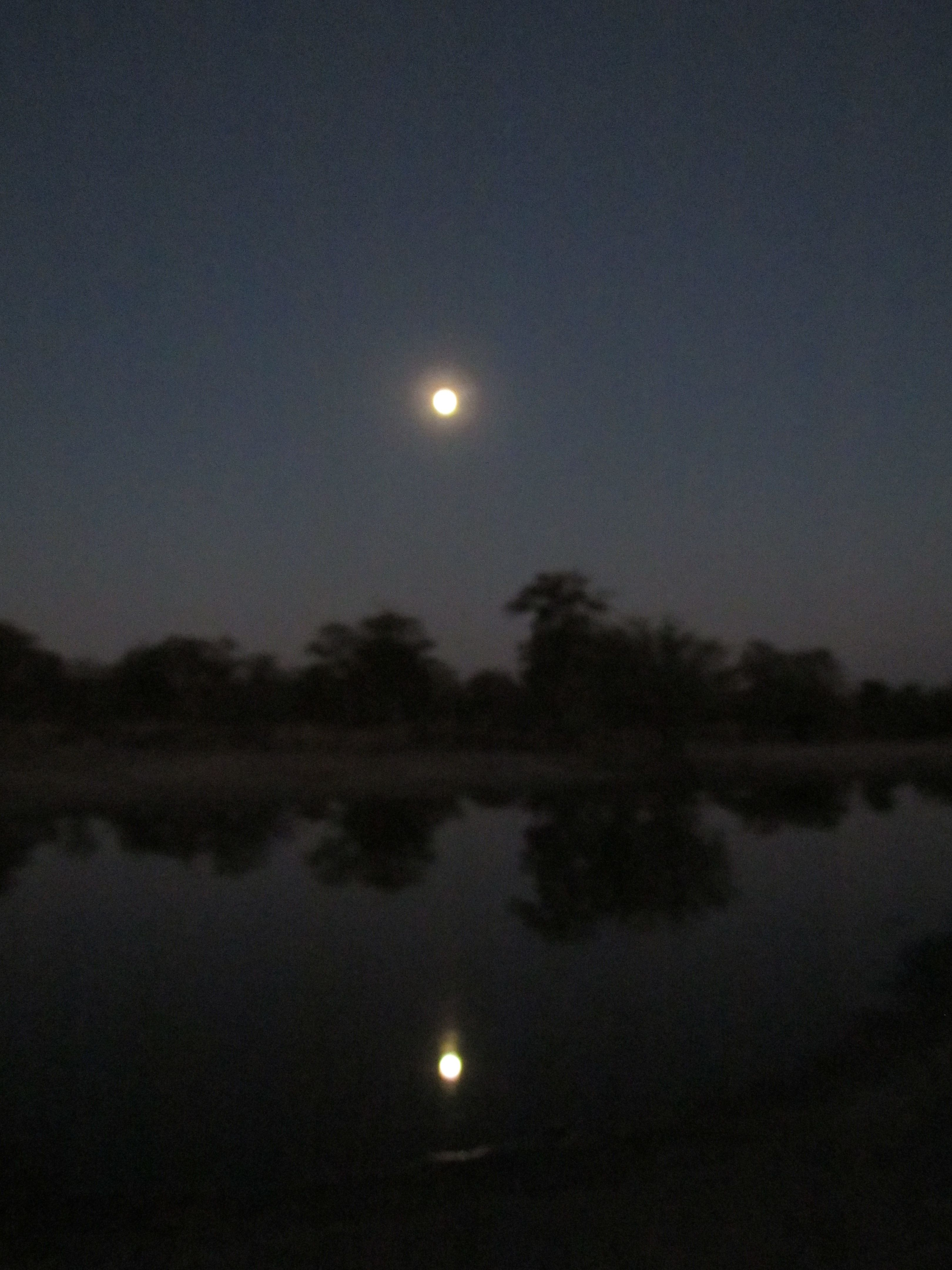 Moonrise over a dam