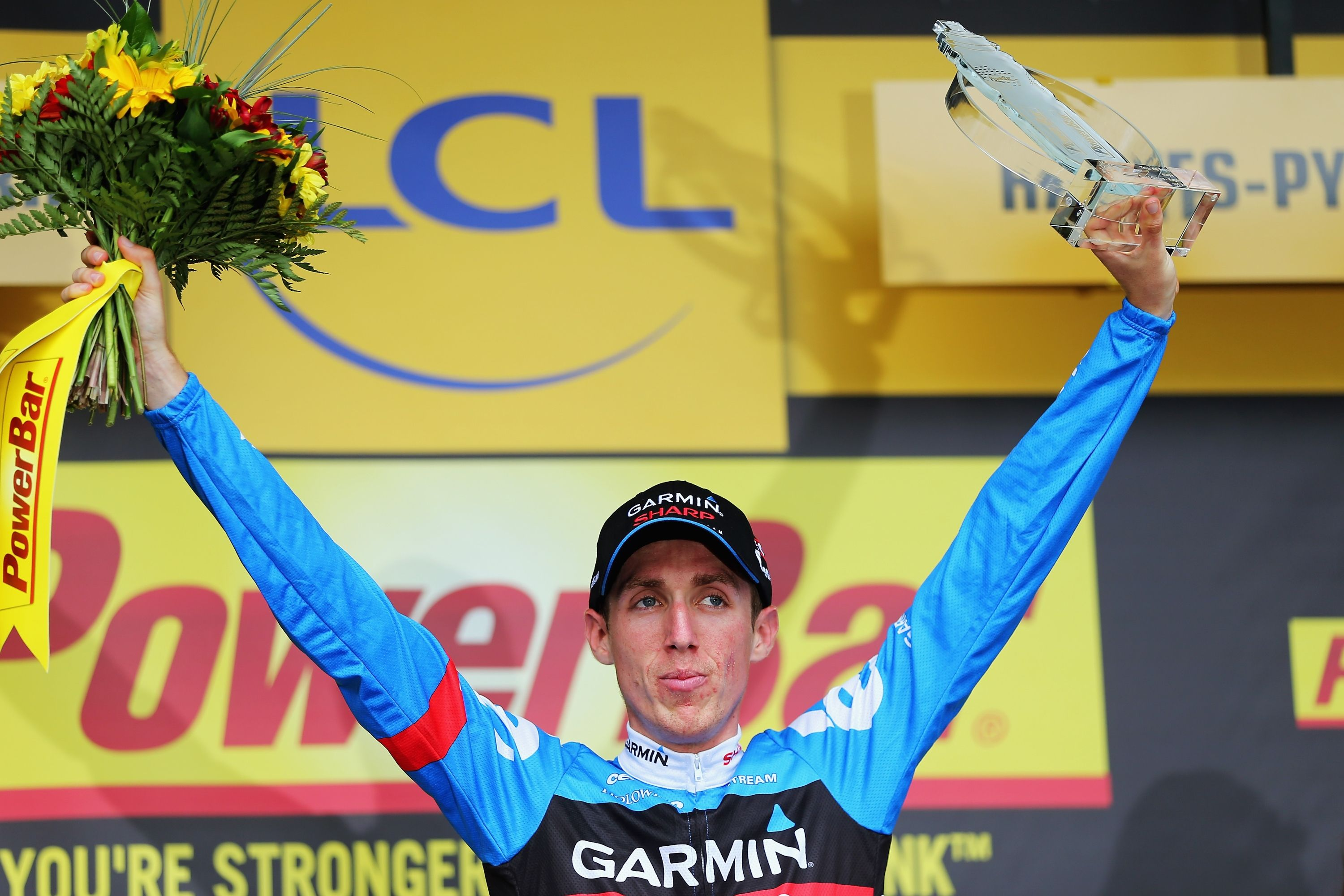 SAINT-GIRONS, FRANCE - JULY 07: Dan Martin of Ireland and Garmin - Sharp cewlebrates winning stage nine of the 2013 Tour de France, a 168.5km road stage from Saint-Girons to Bagneres-de-Bigorre, on July 7, 2013 in Saint-Girons, France. (Photo by Bryn Lennon/Getty Images)
