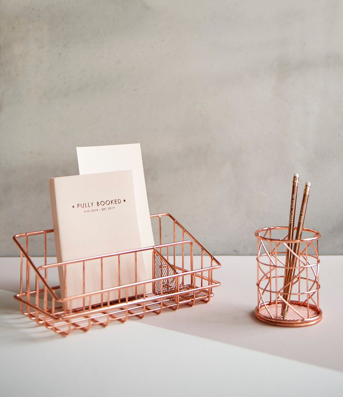 Keeping tidy never got this chic! Our rose gold finish pen pot and
