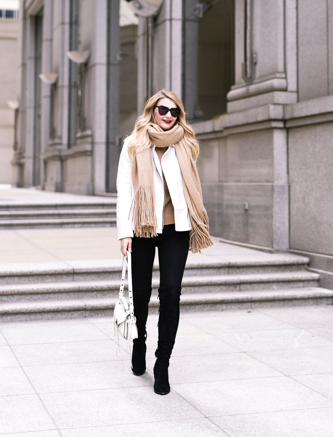 The best black over the knee boots and white suede moto jacket.