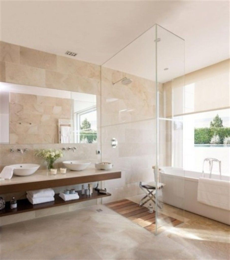 The rustic stone and simple, modern tub and sink surprisingly ...