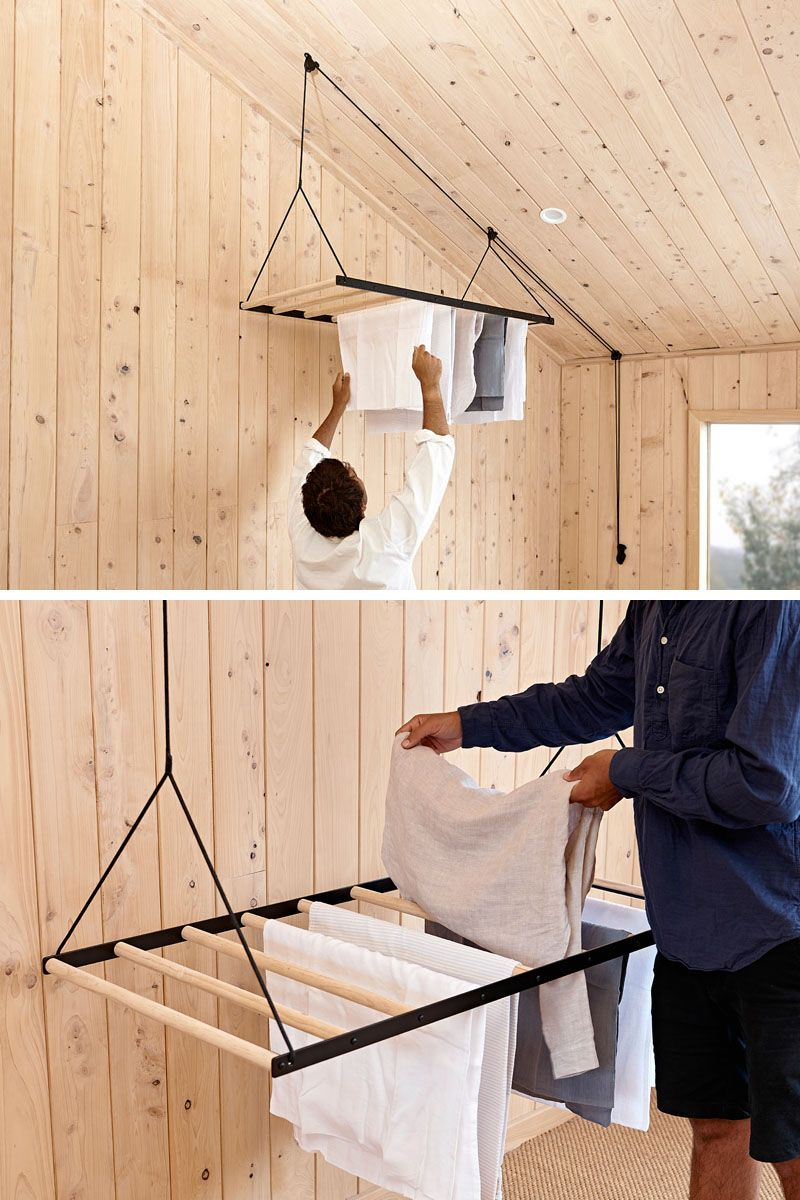 Photo of Since Warm Air Rises, This Suspended Drying Rack Is Designed To Take Advantage Of That By Elevating Clothes Up To The Ceiling