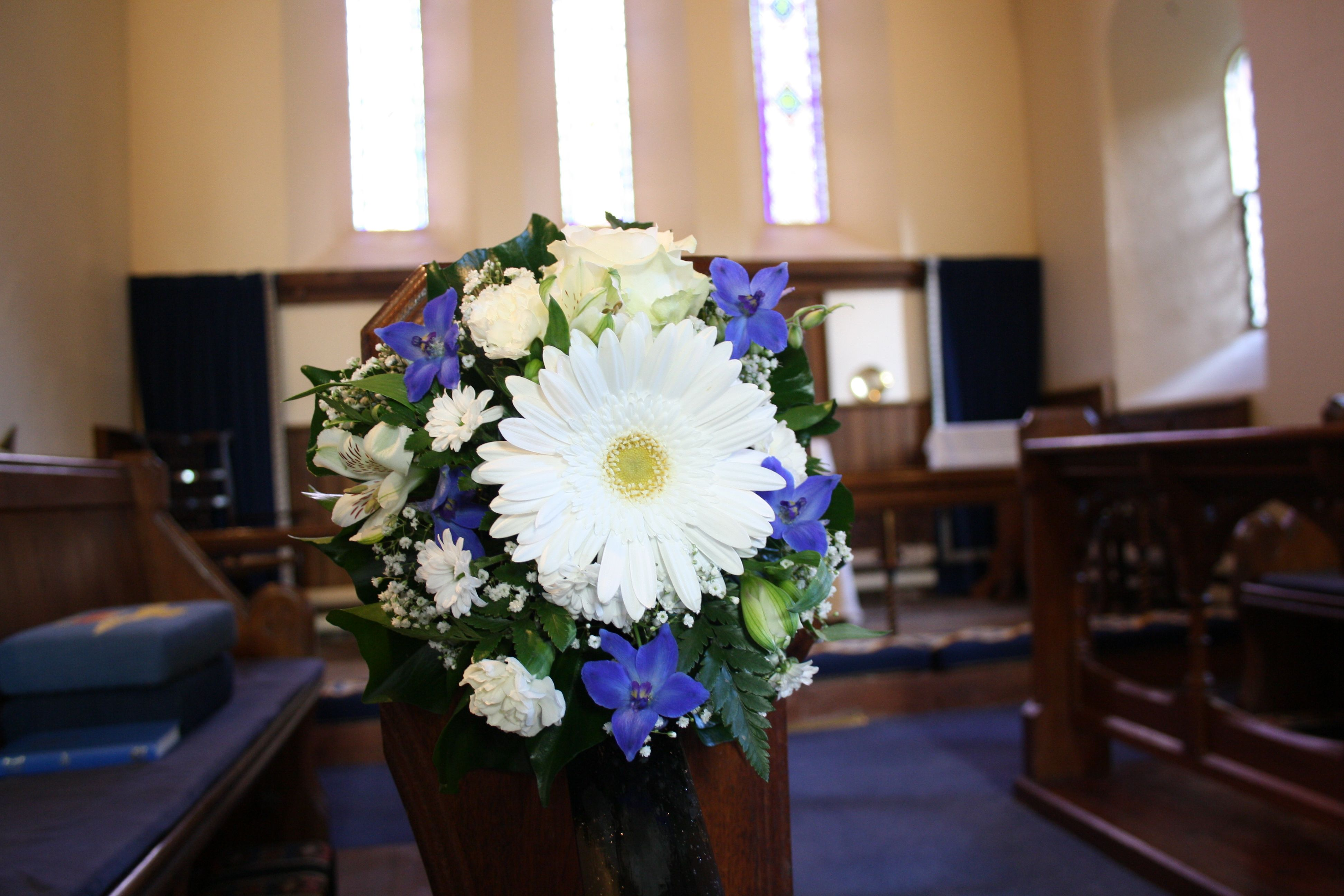 Church Wedding Flowers, pew end arrangement, made from gerbera, delphinium, alstromeria , carnations and gypsophilia, by H J Strike.