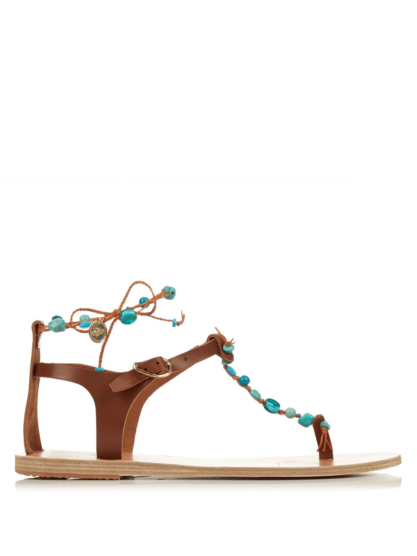12673ab6a316f ... tan-brown leather Chrysso sandals are ornately embellished with  turquoise stones for a bohemian feel. Handmade in Greece