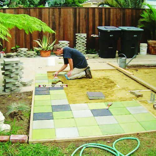 """equal parts sealer, water, and water-based tinted flat exterior house paint makes the """"stain"""" for the pavers."""