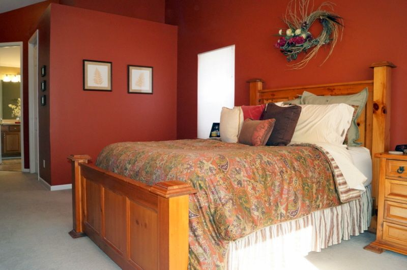 For A Ious Master Bedroom Dark Red Wall Paint Is Choice Paired With Light Ceiling And Carpet Unique Architecture