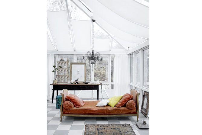 French vintage velvet sofa in a veranda