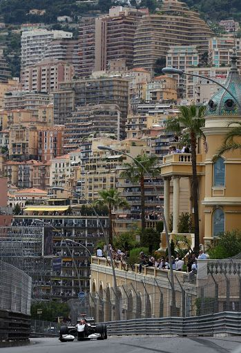 Monaco GPs - 2010 - Michael Schumacher reaches the top of the hill in his Mercedes