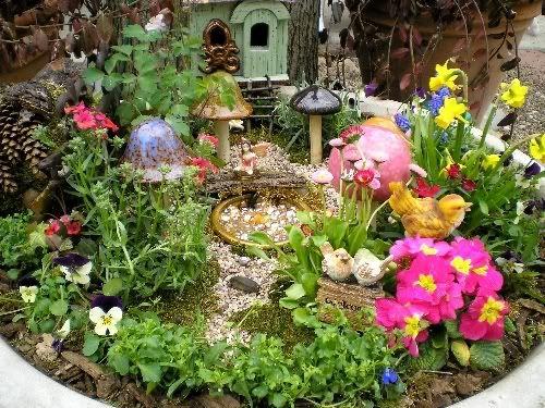 small colorful fairy garden in area of garden outside