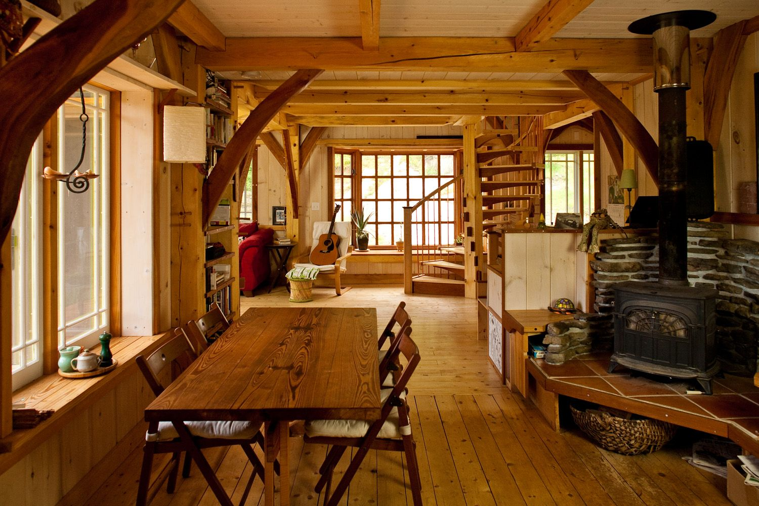 Looking through the dining room towards the spiral for Timber frame cottage