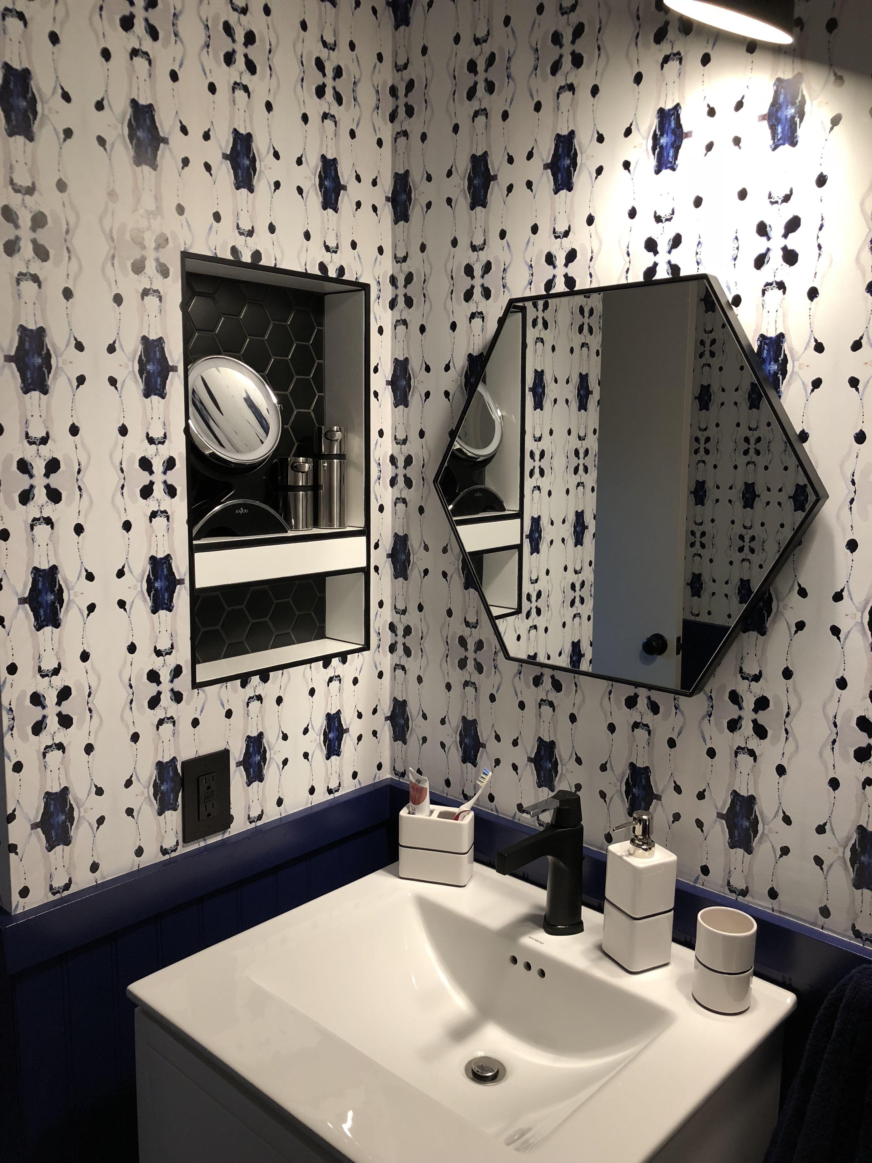Powder room, navy wainscoting, Tamarindo wallpaper from Jennifer Latimer #PictureFrameWainscoting #WainscotingEntryway
