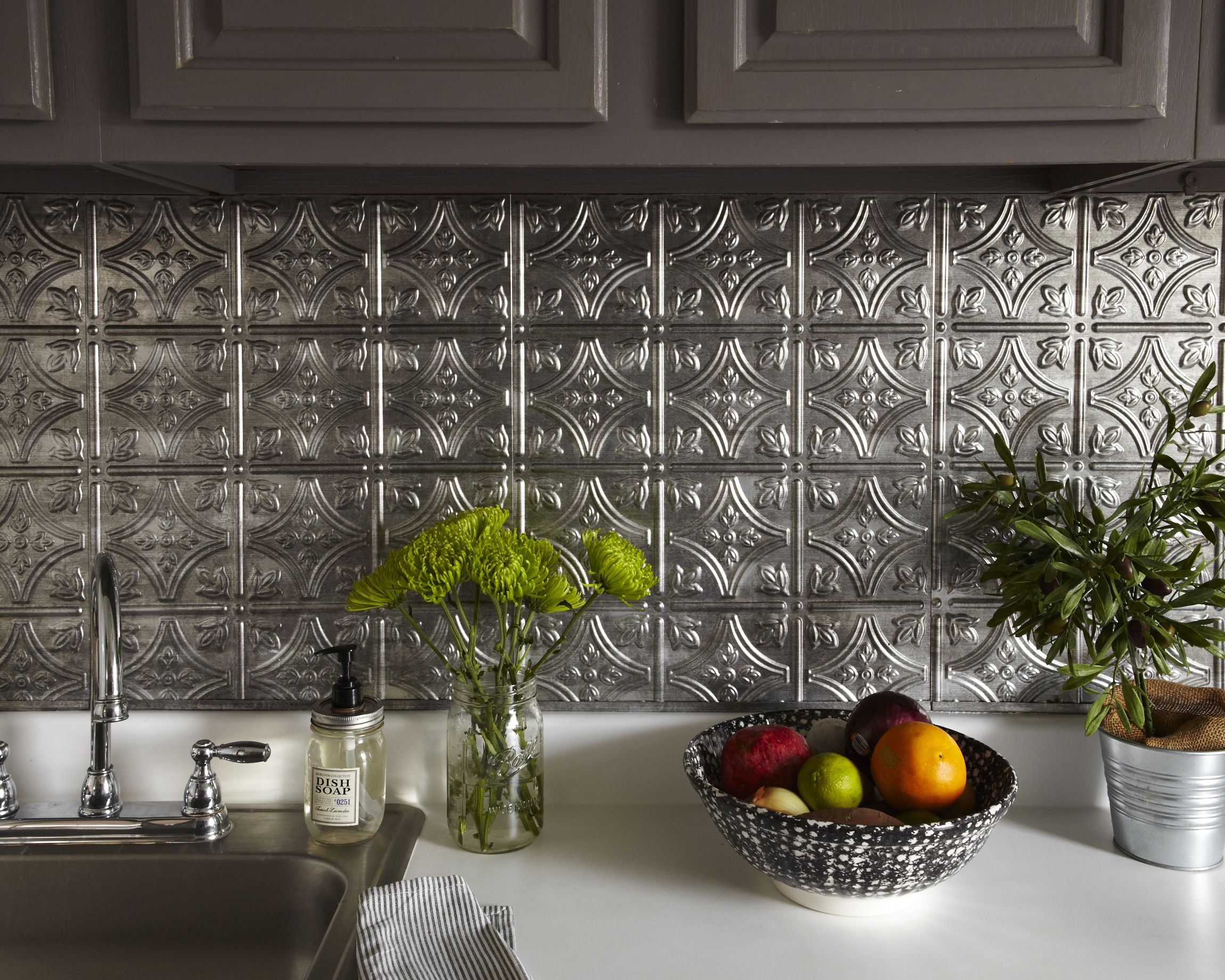 inexpensive plastic sheets that are made to look like old tin ceilings You just Backsplash For KitchenTin