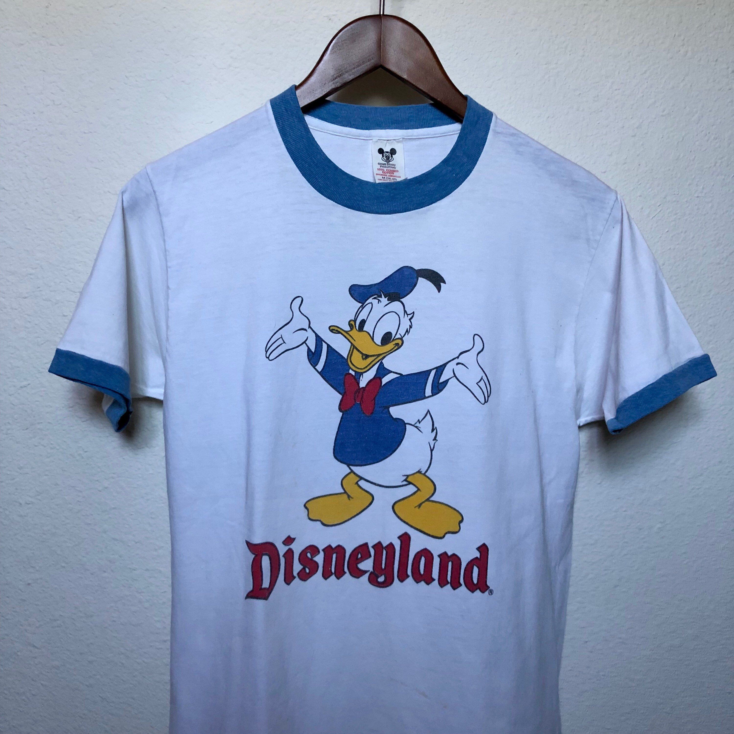 A Personal Favorite From My Etsy Shop Https Www Etsy Com Listing 615249523 Vintage Disneyland Donald Duck Ringer Disneyland Shirts Disney Outfits Disney Tees