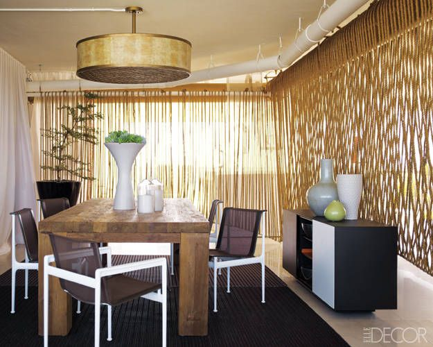 ELLE DECOR's Miami Showhouse - On James J. Wall's covered terrace, chairs by Richard Schultz Design surround a dining table from Jalan Jalan Miami, and the sideboard is by Kettal; the curtain is made of rope from Miami Cordage, and the light fixture is by Corbett Lighting.