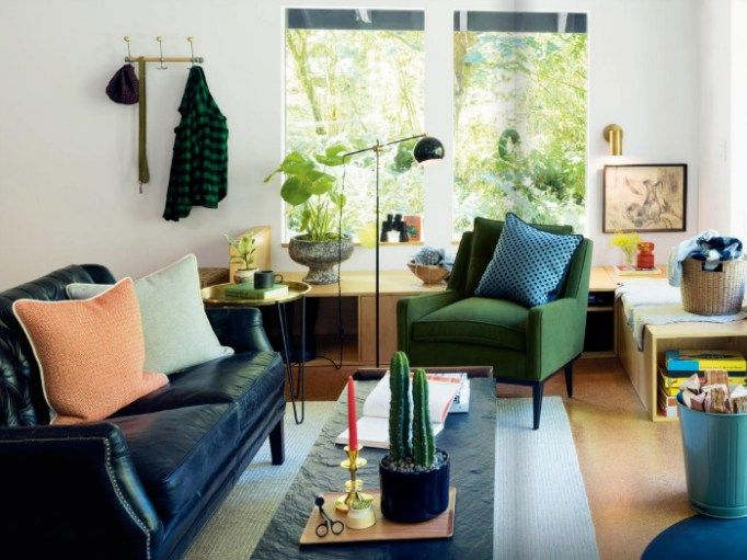 Living room ideas green armchair and black leather sofa from Schoolhouse Electric