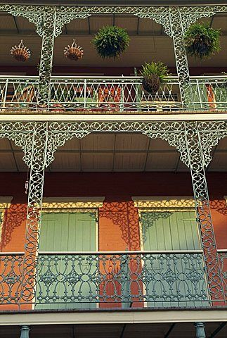 Detail of wrought iron and wooden shutters on balconies of buildings in the French Quarter of New Orleans